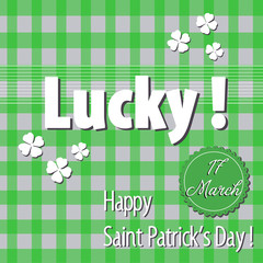 Green background with white clovers and the text lucky, Happy Saint Patrick`s Day written in white