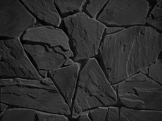 Black color decorative uneven cracked real stone wall