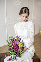 Fashionable and modern bride smiling with happiness and love