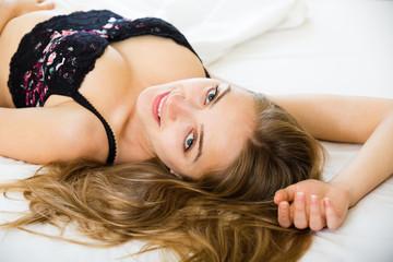 Girl in underwear in bedroom.