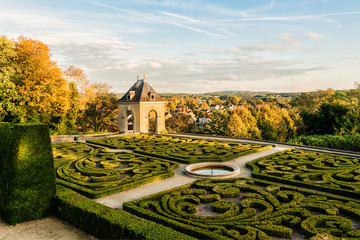 Castle of Auvers-sur-Oise in garden. Sunset. Val-d'Oise, France.