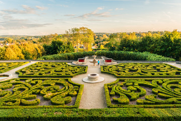 Castle of Auvers-sur-Oise in garden. Sunset. Val-d'Oise, France. Wall mural