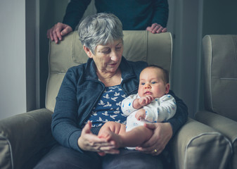Grandparents at home with grandchild