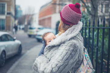 Mother with baby in city