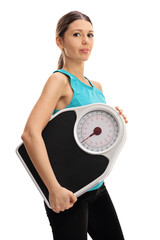 Young woman with a weight scale