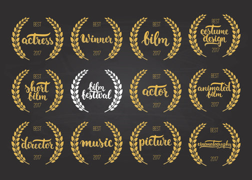 Set of awards for best film, actor, picture, animated, costume design, actress, director, music and winner for movie festival with wreath and 2017 text isolated on the black chalkboard background