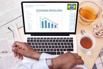 Businessman reads about the state of Brazilian economy