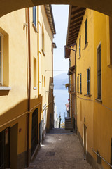 An old alleyway with lake view in Varenna, Lake Como, Lombardy, Italy.
