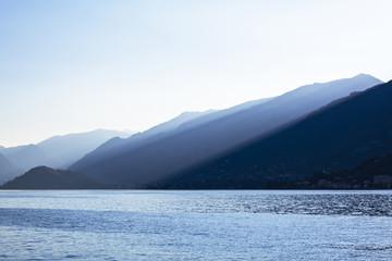 View of Lake Como at dusk looking towards Lenno, Lombardy, Italy.