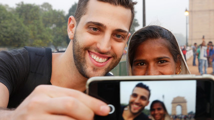 Tourist taking a selfie with a Local Woman in India Gate, New Delhi