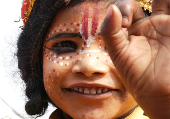 Indian kid dressing like God Shiva in Varanasi, India