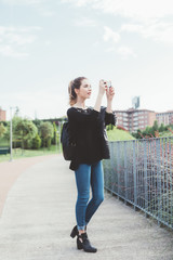 Young woman taking photo smart phone handhold