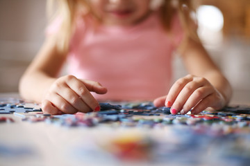 Girl playing puzzle.