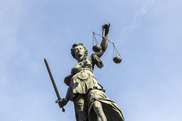 lady justice  under blue sky