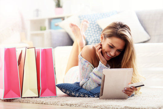 Pretty woman shopping online with credit card