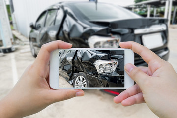 Car crash accident damaged with hand using smartphone taking pho