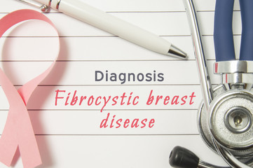 Diagnosis Fibrocystic breast disease. Pink ribbon as symbol of struggle with breast oncology and disorders and stethoscope lying on medical form with text labels Diagnosis Fibrocystic breast disease