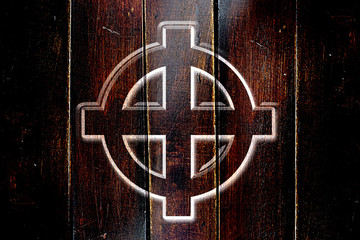 Vintage Celtic cross on a grunge wooden panel