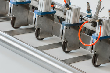 closeup of the machine and equipment are cut and furrowing the felt fabric for automotive filters
