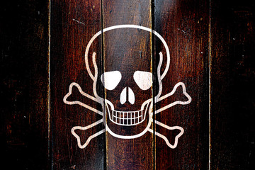 Vintage Pirate flag on a grunge wooden panel