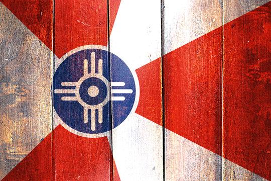 Vintage Wichita flag on grunge wooden panel