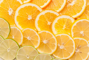 Orange, lemon and lime slices abstract seamless pattern background