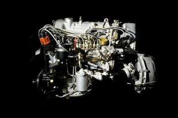 Details of engine close up on black background.