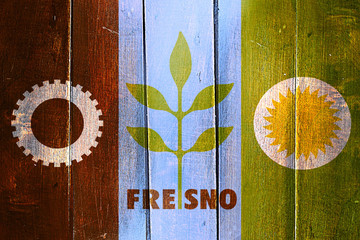 Vintage Fresno flag on grunge wooden panel