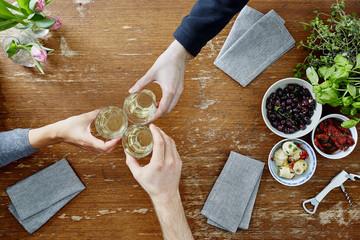three people toasting with wine