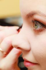Close up woman getting make up, eyeshadow