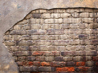 brick wall with damaged plaster, old background texture