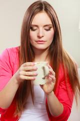 Woman drinking hot coffee beverage. Caffeine.