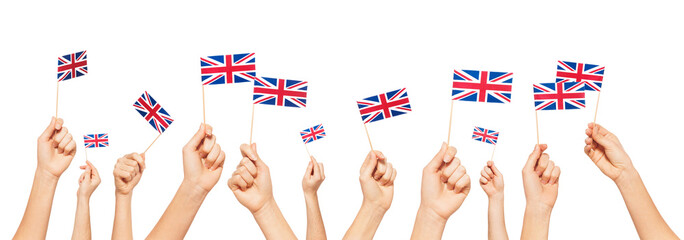 Hands holding and raising flags of Great Britain