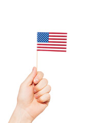 Hand holding small paper flag of America