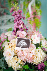 Ultrasound scan of baby on beautiful flowers