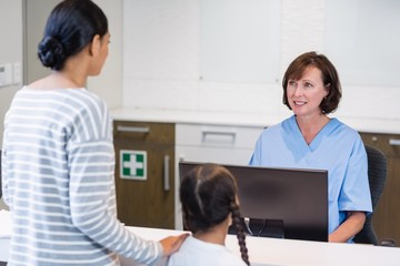 Nurse talking with a patient at counter