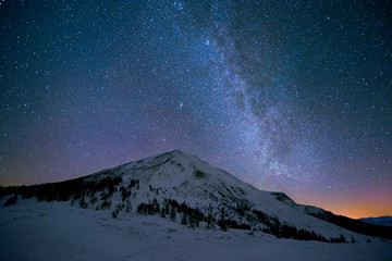 Milky Way over the snowy peaks of the Carpathian Mountains