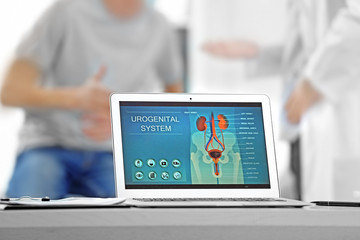 Medical concept. Laptop with urology image on doctor's desk