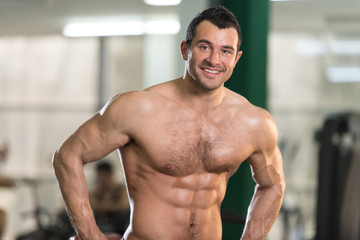 Hairy Man Flexing Muscles