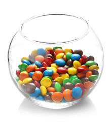 Colorful candies in glass vase on white background