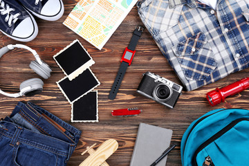 Outfit for travelling on wooden background
