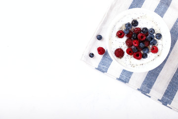 Yogurt with Chia seeds and fresh Raspberries,Blueberries and Honey.Concept of Healthy Eating.Breakfast.Copy space. selective focus.
