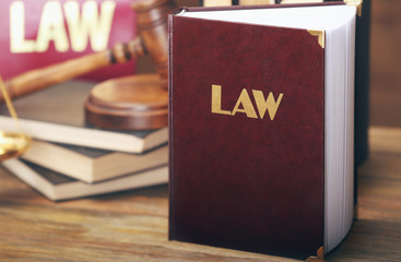 Law book on wooden background