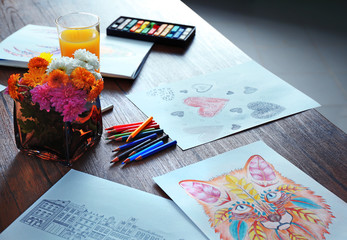 Coloring pictures for adults on table