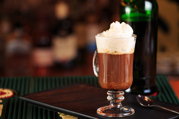 Irish coffee in a bar. Concept of St Patrick holiday. Holiday ba