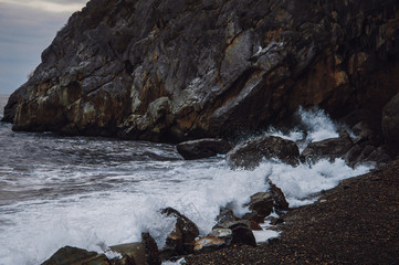 Sea waves crash on the rocks on the beach. Sea shtormit. Splashing waves.