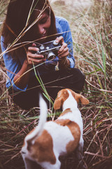 Shot of hipster woman taking a snapshot of her dog.