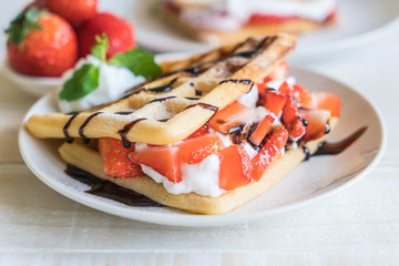 waffle with strawberry on wood