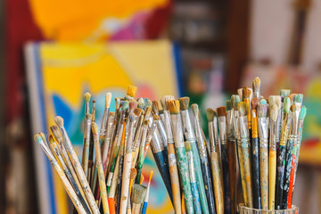 a lot Paint Brushes isolated in blur background, close-up
