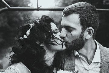 Sensual portrait of kissing couple close-up. Wind in her hair